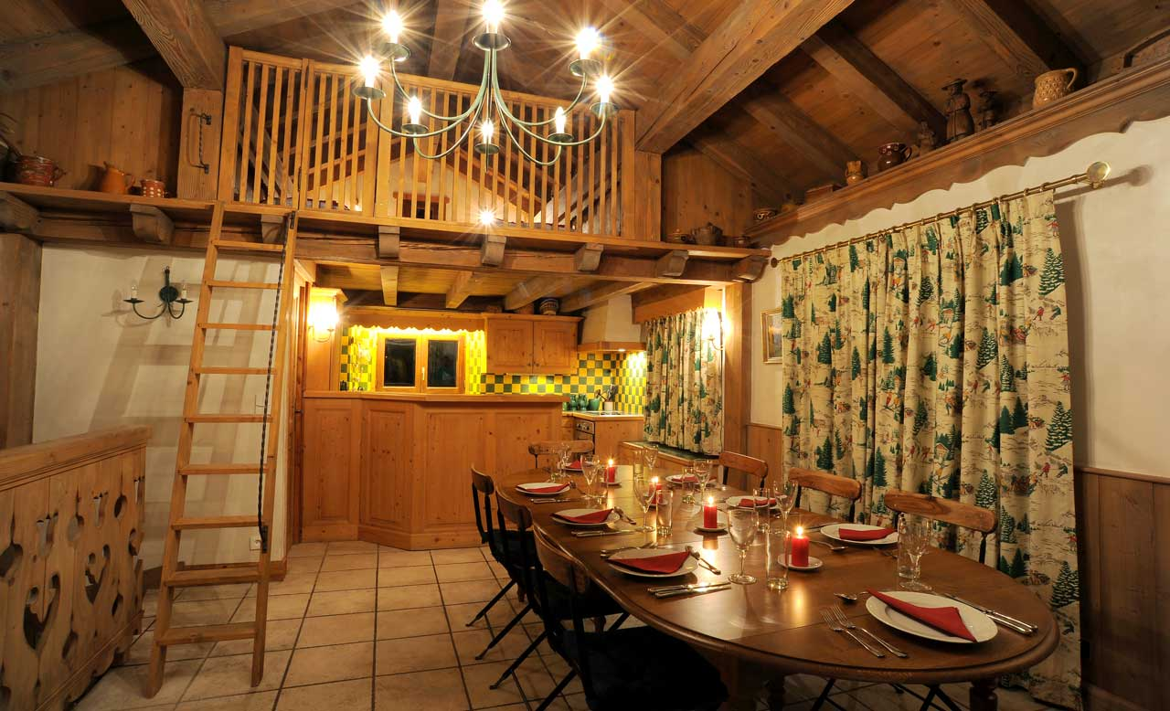 Dining room and mezzanine bedroom from The Freeride Republic